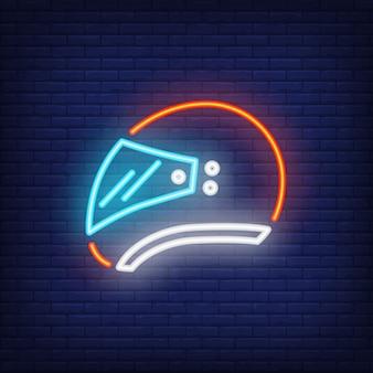 Side view of biker helmet on brick background. Neon style