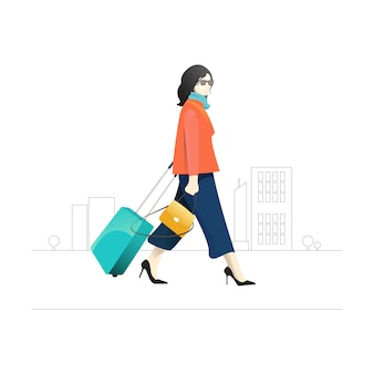 Side view of woman with her luggage