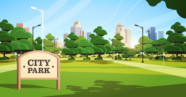 Sign board in city park beautiful summer day skyline skyskraper buildings sunrise cityscape background