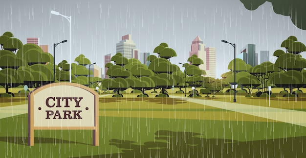 Sign board in city park rain drops falling rainy summer day skyline skyskraper buildings cityscape