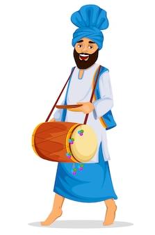 装飾されたドラムを持つシーク教徒の男