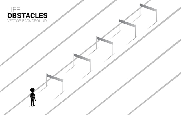 Silhouette boy standing with hurdles obstacle. background concept for obstacle and challenge in future.