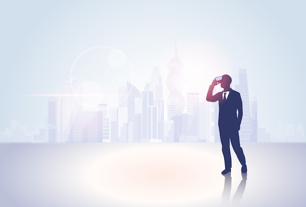 Silhouette business man wear virtual reality digital glasses big city background