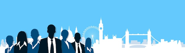 Silhouette business people over london city view