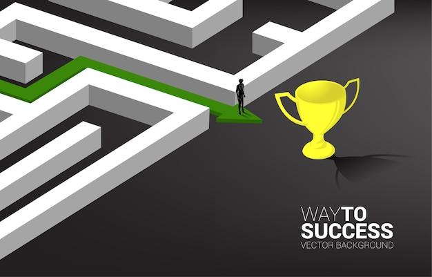 Silhouette of businessman on arrow with route path to exit the maze to golden trophy.