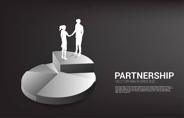 Silhouette of businessman and businesswoman handshake on pie chart. concept of team work partnership and cooperation.