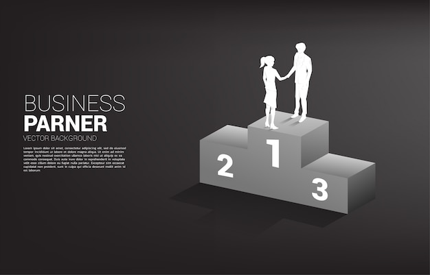 Silhouette of businessman and businesswoman handshake on top of podium. concept of team work partnership and cooperation.