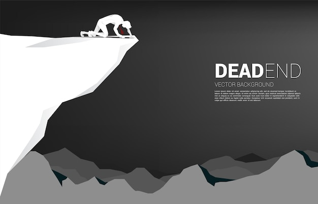 Silhouette of businessman crawling on the cliff. concept for dead business and obstacle.