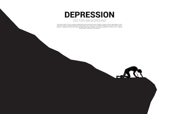 Silhouette of businessman crawling on down hill. concept for depression and down turn business.