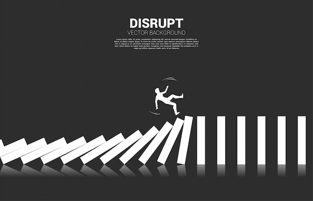 Silhouette of businessman falling on collapse domino