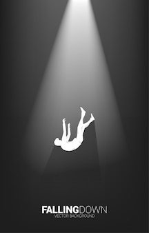 Silhouette of businessman falling down in the light. concept for fail and accidental business
