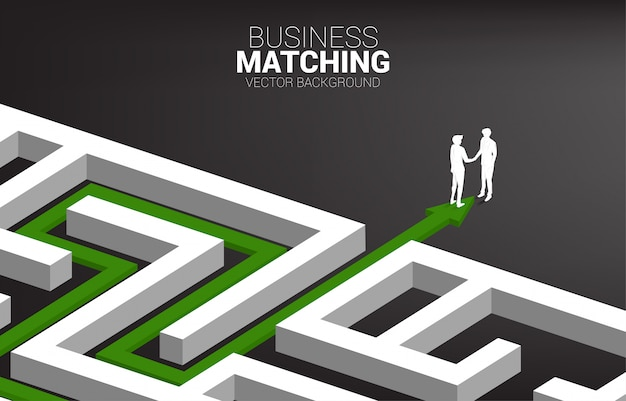 Silhouette of businessman handshake at exit from maze. concept of business matching. team work partnership and cooperation.