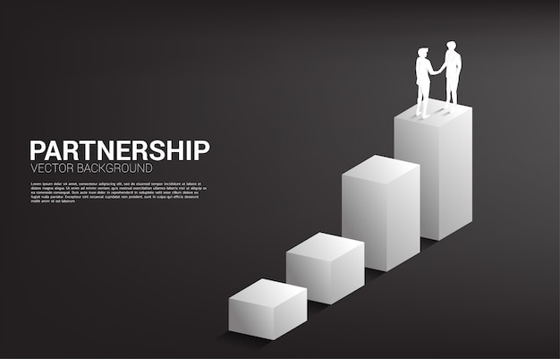 Silhouette of businessman handshake on growing graph. concept of team work partnership and cooperation.