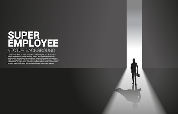 Silhouette of businessman and his shadow of superhero from light of exit way.concept of empower potential and human resource management