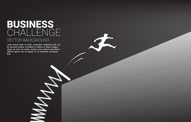 Silhouette of businessman jump across the wall with springboard