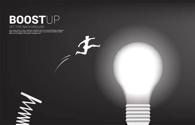 Silhouette of businessman jump to light bulb with springboard . business concept of creative idea and solution.