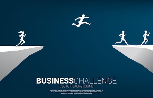 Silhouette of businessman jumping over the gap of valley with city background. concept of business challenge risk.