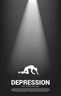 Silhouette of businessman on knee in the light. concept for fail and depress people. Premium Vector