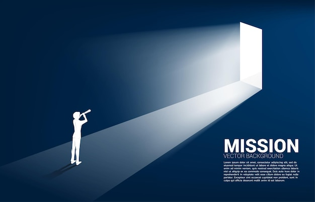 Silhouette of businessman looking through telescope to exit door. business concept for mission and finding trend.