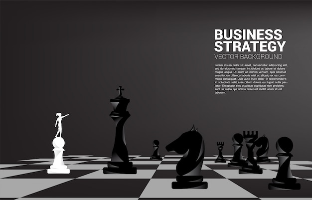 Silhouette of businessman point forward with chess piece.