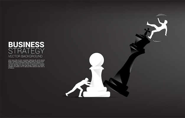 Silhouette of businessman push pawn chess piece to checkmate the king with falling down businessman.