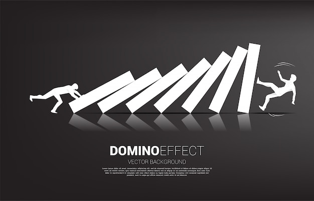 Silhouette of businessman pushing to collapse domino to another businessman. business concept of business disruption and domino effect