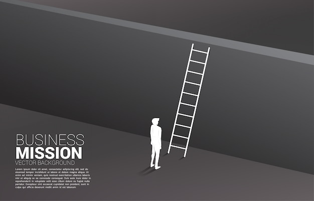 Silhouette of businessman ready to cross the wall with ladder. concept of vision mission and goal of business