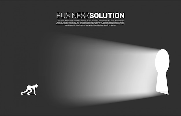 Silhouette of businessman ready to run out to key hole door.