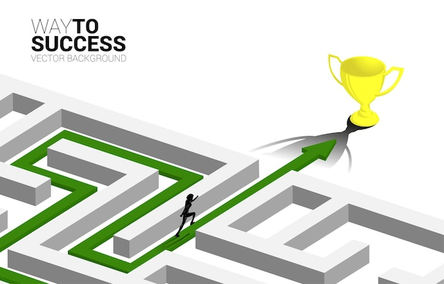 Silhouette of businessman run on arrow with route path to exit the maze to golden trophy. business concept for problem solving and solution strategy