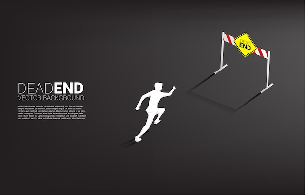 Silhouette businessman run to dead end signage . concept of wrong decision in business or end of career path.