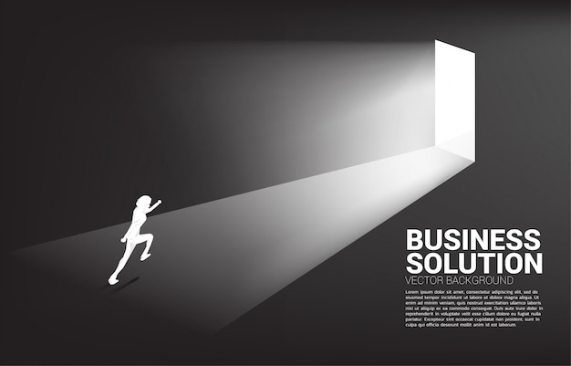 Silhouette of businessman running to exit door. concept of career start up and business solution.