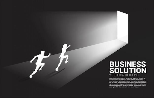 Silhouette of businessman running to exit door.