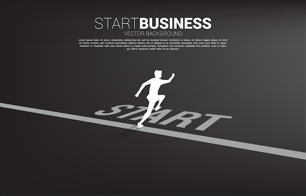 Silhouette of businessman running from start line.