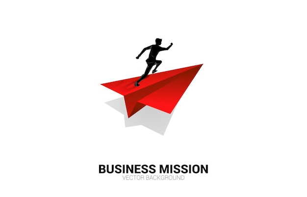 Silhouette of businessman running on red origami paper airplane. business concept of leadership, start business and entrepreneur