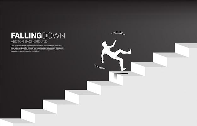 Silhouette of businessman slip on stair.