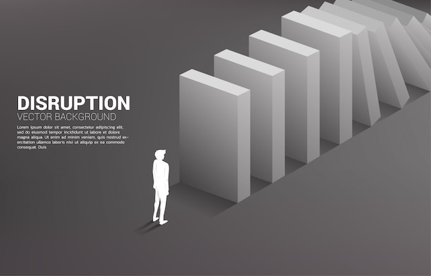 Silhouette of businessman standing at the end of domino collapse. concept of business industry disrupt