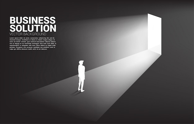 Silhouette of businessman standing in front of exit door. concept of career start up and business solution.