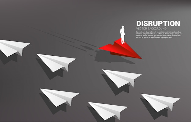 Silhouette of businessman standing on red origami paper airplane go different way from group of white. business concept of disruption and vision mission.