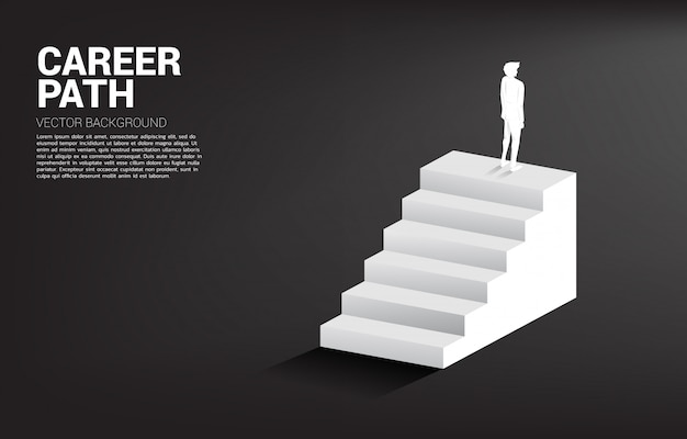 Silhouette of businessman standing on top of a stair