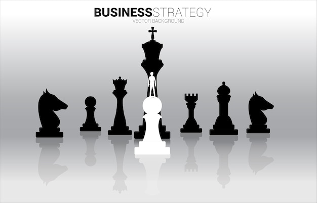 Silhouette of businessman standing on white pawn chess piece in front of all of black chess piece .