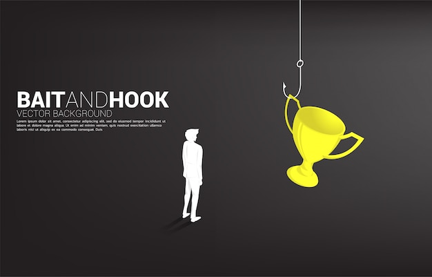 Silhouette of businessman standing with fishing hook with trophy. concept of bait and hook in business rewards..