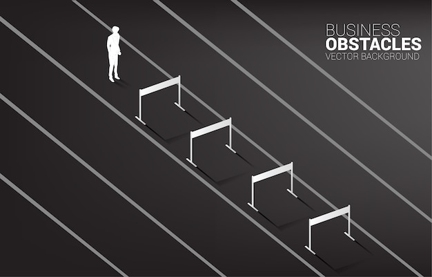 Silhouette businessman standing with hurdles obstacle.