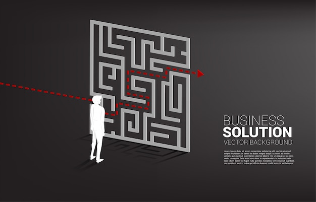Silhouette of businessman standing with plan to exit from maze . business concept for problem solving and solution strategy