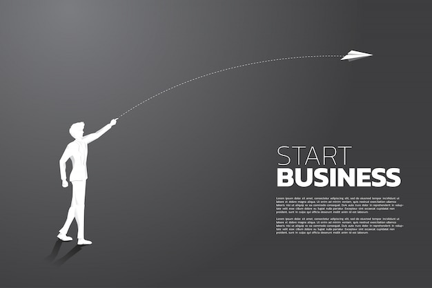 Silhouette of businessman throw out origami paper airplane. business concept of start business and entrepreneur