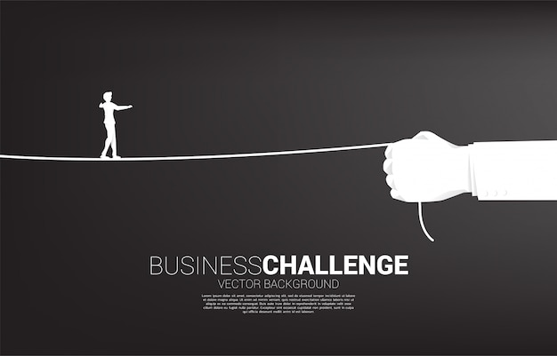 Silhouette of businessman walk rope in businessman hand. concept of business challenge and career path.