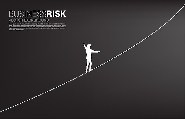Silhouette of businessman walking on rope walk way.concept for business risk and career path