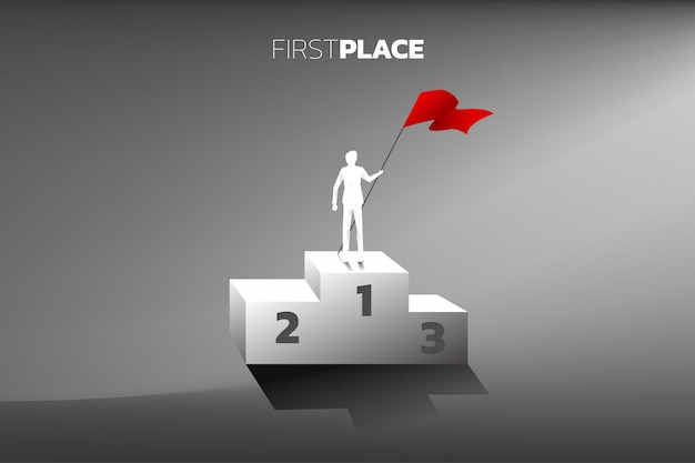 Silhouette of businessman with red flag on champion podium.
