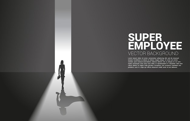 Silhouette of businesswoman and her shadow of superhero from light of exit way.concept of empower potential and human resource management