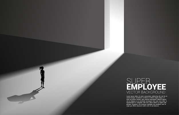 Silhouette of businesswoman and his shadow of superhero from light of exit way.concept of empower potential and human resource management