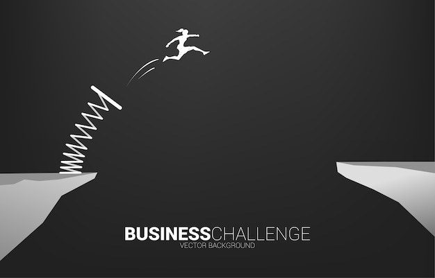 Silhouette of businesswoman jump over the gap with springboard. concept of boost and growth in business.
